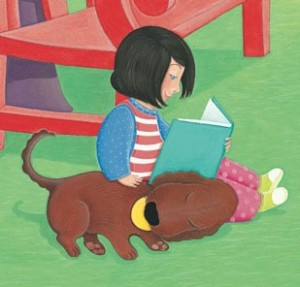 child and dog reading